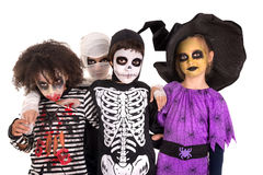 Kids in Halloween costumes. Kids with face-paint and Halloween costumes isolated in white Royalty Free Stock Photo