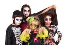 Kids in Halloween costumes Stock Images