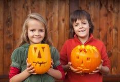 Kids with Halloween pumpkin jack-o-lanterns Stock Photography