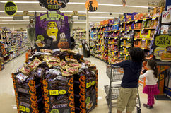 Kids Halloween shopping. Kids were looking at the Halloween decoration at a grocery store royalty free stock images