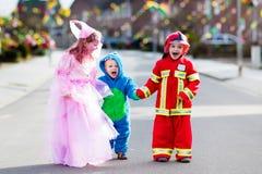 Kids on Halloween trick or treat. Royalty Free Stock Photo