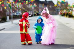 Kids on Halloween trick or treat. Stock Images