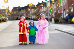 Kids on Halloween trick or treat. Stock Photos