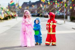 Kids on Halloween trick or treat. Royalty Free Stock Photo