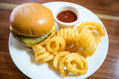 Kids Hamburger Meal With French Fries. A hamburger with twister fries or chips on a bowl. Great for lunch meals Stock Photography