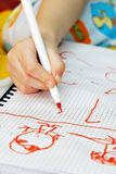 The kids hand draws felt-tip pens on paper Stock Photography