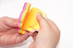 Kids hand holding  colorful sticky stickers Royalty Free Stock Photos