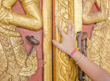 Kids hand open the temple gate Royalty Free Stock Photography