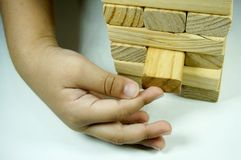 Kids hand playing with woodblock. Kids hand touching and playing with wood blocks royalty free stock photography