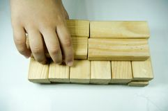 Kids hand playing with woodblock. Kids hand touching and playing with wood blocks stock photography