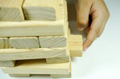 Kids hand playing with woodblock. Kids hand touching and playing with wood blocks stock photo