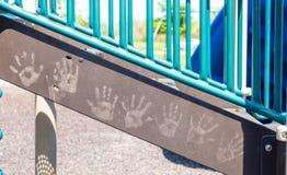 Children`s hand prints. Kids hand prints on playground equipment stock photo