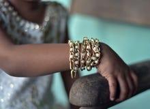 Kids hand with stylish bracelets ornaments stock photograph royalty free stock photo