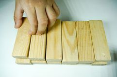 Kids hand playing with woodblock. Kids hand touching and playing with wood blocks stock image