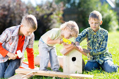 Kids hand working together on lawn at summertime Royalty Free Stock Photos