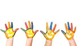 Kids hands in colorful paint with smiles Royalty Free Stock Images
