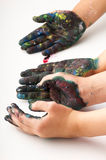 Kids hands covered with paint. On the white stock image