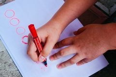 Kids hands drawing on a paper royalty free stock photo