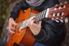 Kids Hands of the guitarist close up Royalty Free Stock Photography