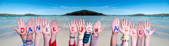 Kids Hands Holding Word Danke Euch Allen Means Thank You All, Ocean Background
