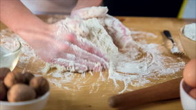 Kids hands kneading the dough stock video