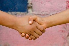 Kids handshake Stock Photo