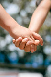 Kids handshake closeup on sunny outdoors background Royalty Free Stock Photography