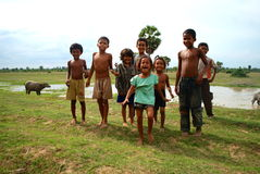Kids happy playing Cambodia in the village. Jumping for joy Stock Image