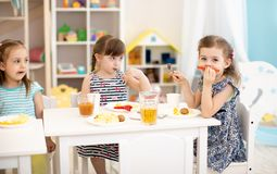 Free Kids Have A Lunch In Daycare Centre. Children Eating Healthy Food In Kindergarten. Little Girl Have Fun Showing Mustache Stock Images - 148409674