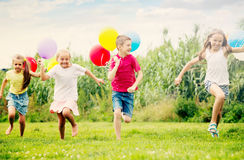 Kids have fun with balloons Royalty Free Stock Image