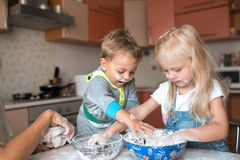 Kids have fun with kids at kitchen. Boy and girl have fun with kids on kitchen royalty free stock photo