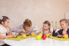Kids have lunch at home Stock Images