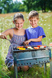 Kids having a barbecue party Royalty Free Stock Image