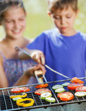 Kids having a barbecue party Stock Image