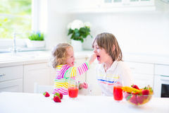 Kids having breakfast Stock Image