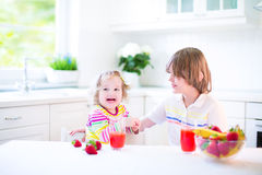 Kids having fruit for breakfast Royalty Free Stock Photos