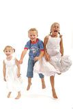 Kids having fun. 2 girls, 1 boy isolated on a white background Stock Photography
