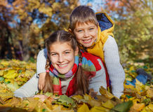 Kids having fun in autumn park Royalty Free Stock Photos