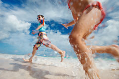 Kids having fun at beach. Happy kids running and jumping at beach Royalty Free Stock Image