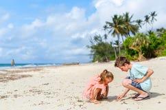 Kids having fun at beach Stock Images