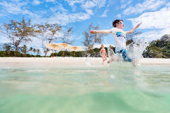 Kids having fun at beach Stock Image