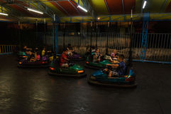 Kids Having Fun On Bumper Cars Stock Image