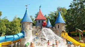 Kids having fun castle water park. Kids having fun at castle water park stock footage