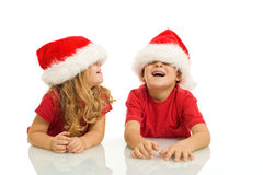Kids having fun with christmas hats Stock Photos