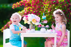 Kids having fun at garden tea party Stock Photos