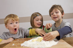 Kids having fun making dough. With their hands stock image