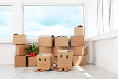 Kids having fun while moving in a new home Royalty Free Stock Photo