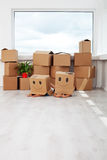 Kids having fun while moving in a new home royalty free stock photos