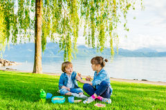 Kids having fun outdoors Stock Images