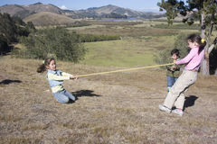 Kids having fun in park Stock Image